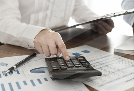 Accountant making calculations. Bookkeeping, Finances and Accounting Concept. Stock Photo