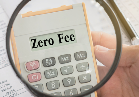 zero fee text displayed on calculator and magnifier. bank fees, service fee concept. Stock fotó