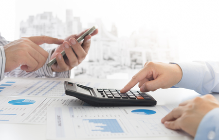 Manager analyze financial numbers to view the performance of the company. Concept of analyze data, business analytics, financial planning, financial services. Stock Photo