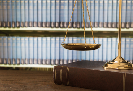 scales of justice on law books in a courtroom or law firm. concept of law,legal education. Foto de archivo
