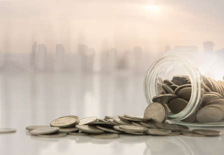 Savings, Finance and Banking Concept. Coins stack with city background.  스톡 콘텐츠
