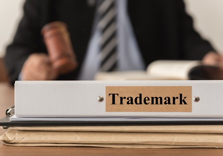closeup trademark document folder with lawyer work at law firm. concept of trademark law. 版權商用圖片