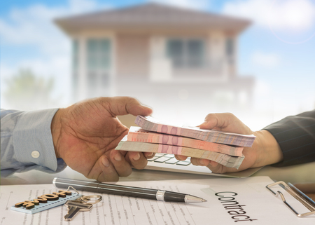 Mortgage loan real estate property concept. Banker give loan money to debtor.