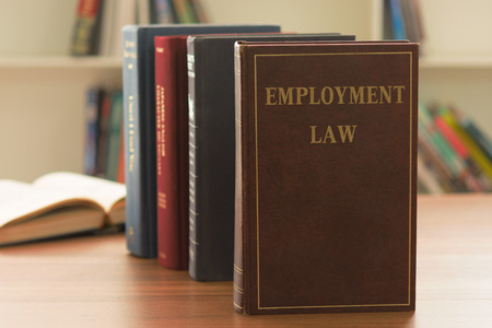 employment law book on desk of lawyer in law firm. legal education concept. Stock Photo