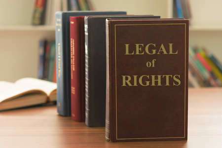 law book of legal of rights on desk of lawyer in law firm. Legal counseling concept.
