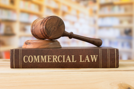 commercial law books and a gavel on desk in the library. concept of legal education. Stock Photo