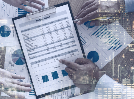 Financial analyst analyzing business data on desk. top view.  Accounting concept. Stock Photo