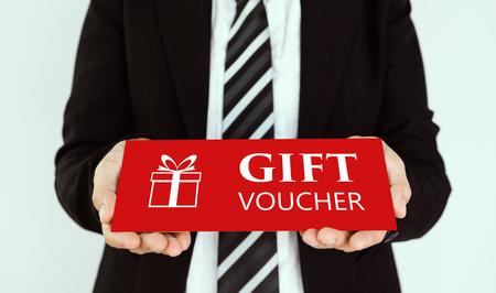 Gift voucher concept. Businessmen send red gift voucher card.
