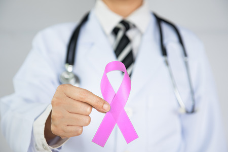 Doctor Holds Pink Ribbon,  International Breast Cancer Day October 7