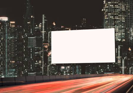 Blank template  for outdoor advertising or blank billboard on the highway during the twilight. With clipping path on screen - can be used for trade shows, and advertising or promotional poster. Standard-Bild - 116708294