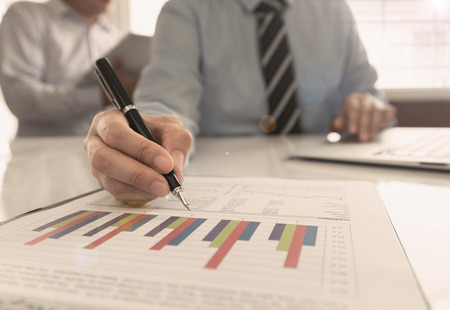 financial advisor are business analysis for new project planning. Standard-Bild - 119797762