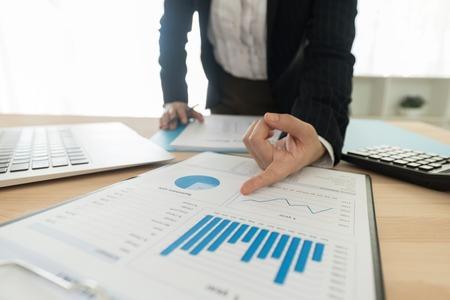 Fund Manager analyzing investment charts. concept of investment portfolio management plan. Standard-Bild - 119798015