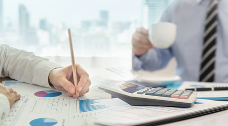 Financial advisor team are analyzing return on investment from business charts report. Concept of financial planning, accounting and data analysis. Standard-Bild - 119798017
