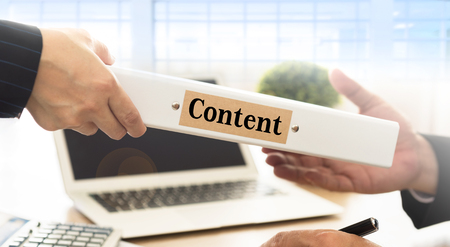 Office worker sends advertising content document to marketing manager. Standard-Bild - 119798088