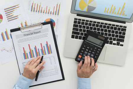 Financial analyst reviewing data in financial statement. Accounting , Accountancy Concept. top view. Standard-Bild - 119798092