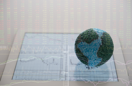 World of business investment finance. Globe on digital tablet with stock market data background. Standard-Bild - 119798098