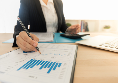 Business women reviewing data in financial statement. Accounting , Accountancy, financial analysis  Concept. Standard-Bild - 119798685