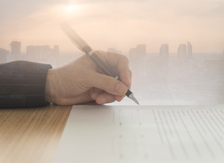 Business people signing contract business deals with real estate background. Standard-Bild - 119798688