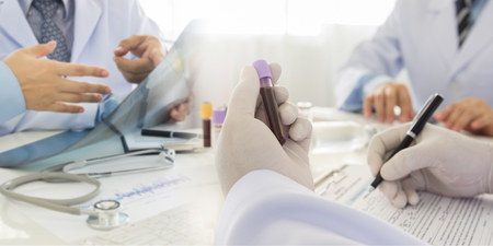 Medical test, Blood sample in tube with team doctors diagnose for treatment patient. Standard-Bild - 119798690