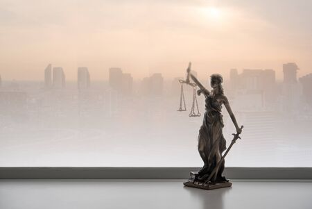 Justice law legal concept. Statue of justice with city Zdjęcie Seryjne