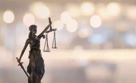 Justice law legal concept. statue of justice or lady justice with bokeh Stock Photo