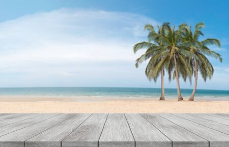 Wooden table and view of tropical blurred beach