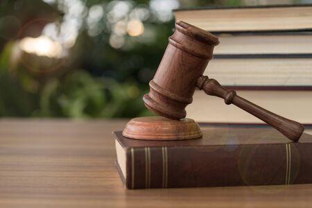 Judges gavel resting on law books.  concept of legal ruling Jurisprudence, law education.