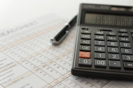 bookkeeping accounting concept. calculator on financial statement and balance sheet annual. Stok Fotoğraf - 129190757