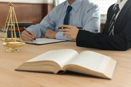 Law and Legal services concept. Lawyer and attorney having team meeting at law firm. Banco de Imagens