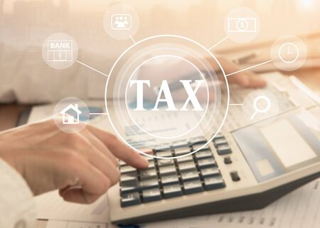 women using calculator calculated individual income tax for pay taxes annual. Stock Photo