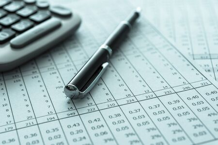 accounting business concept. pen, calculator, financial statement on accountant's desk. Stock Photo
