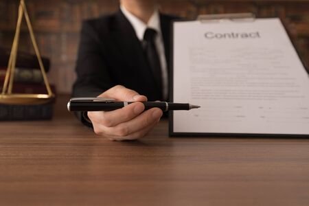 businessman giving pen for your signature on contract document. Stock fotó