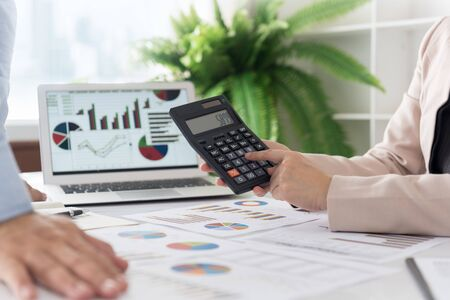 Businesswoman and financial adviser calculating and discussing business documents. Stock fotó