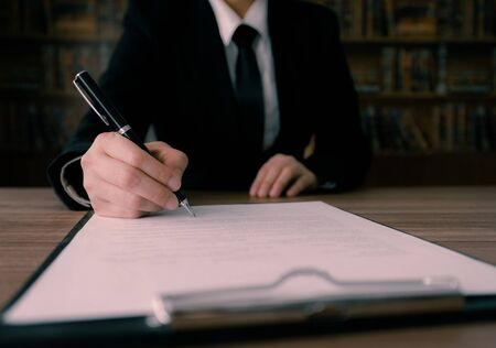 Businessman signing contract or agreement business deal or employment contract.