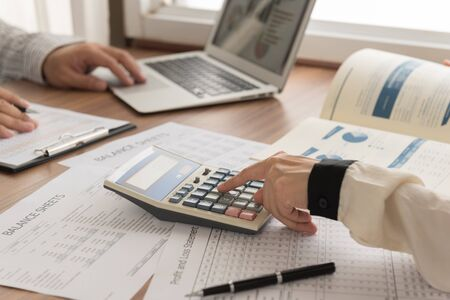 Business analyst team checking in financial statement for audit internal control system. Stock Photo