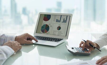 Administrator team analyze data in statistic spreadsheet on screen laptop