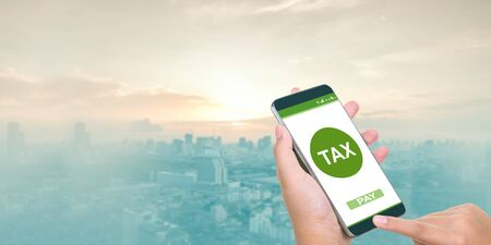 Filing taxes online using smartphones and the internet on mobile.