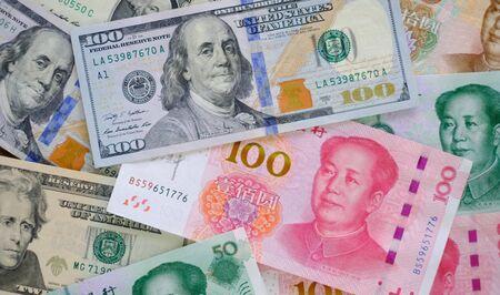 Close up yuan banknotes and dollar banknotes.
