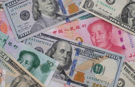Close up yuan banknotes and dollar banknotes. Zdjęcie Seryjne