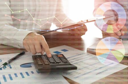 Financial analyst analyzing business report to view the performance and return on investment results of the company.