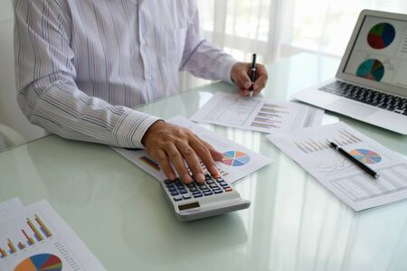 Businessman checking in financial statement for audit internal control system. Accounting , Accountancy Concept.