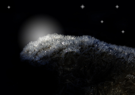 Ice crystals glisten on the stone and shine into the night.