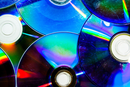 VCD and DVD Discs on Ground Stock Photo