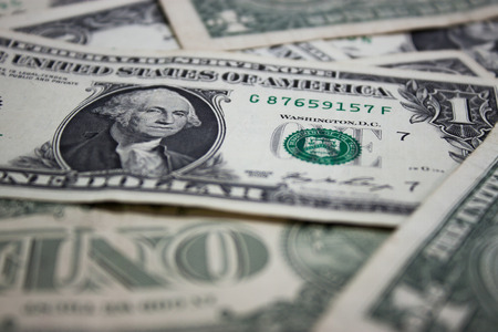 pay wall: dollar banknotes 1 dollar on ground