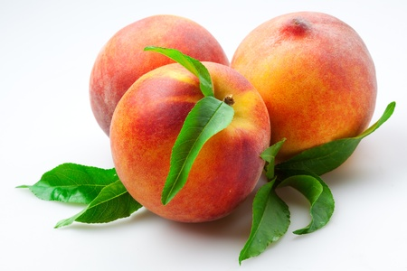 Juicy Peaches with leaves. Fruits Isolated on White Background photo