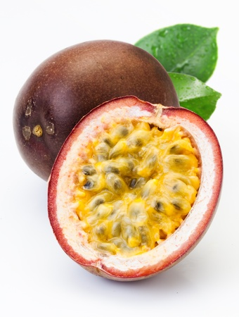 fresh fruits: Passion fruit with leaves isolated on a white background
