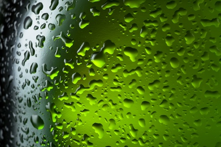 Water drops texture on the bottle of beer. Abstract background with selective focus photo