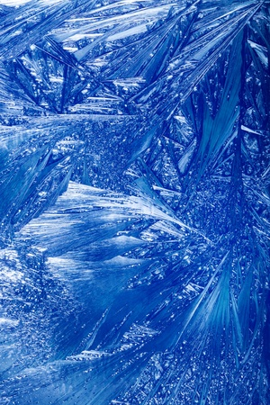 iceflower: Abstract Winter background. Christmas abstract frostwork on a window glass