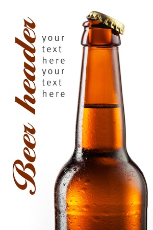 Bottle of beer with drops isolated on white. Beer background