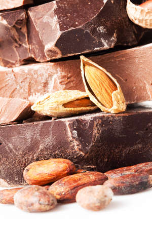 variety of chocolate  pieces with cocoa beans and almond nuts Stock Photo - 12894393